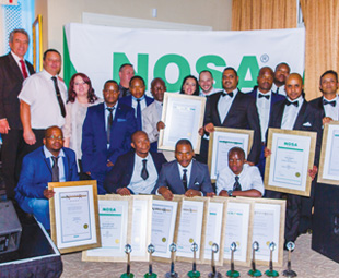 Above: Proudly displaying the 2017 haul of Noscar awards are (back row, from left): Kobus Visagie, divisional director; Albertus Smit, contracts manager; Johnnie Van Niekerk, HSE coordinator; John Rodgers, HSE coordinator; Christiaan Richards, senior HSE officer; Jonas Nhlapo, senior HSE officer. Middle row, from left: Abra Chego, site manager; Johannes Mofokeng, HSE officer; Solomon Selepe, HSE officer; Madelein Maclellan, HSE officer; Vivien Govender, KZN HSE manager; Sbonelo Mbuyazi, HSE officer; Thabo Modumaela, national HSE-risk manager; Yususf Wilfred, site manager. Front row, from left: Lawrence Kgonyana, field HSE manager; Ishmael Taunyane, site manager; Erasmus Gumede, HSE officer; Williem Ngwenya, senior HSE officer.